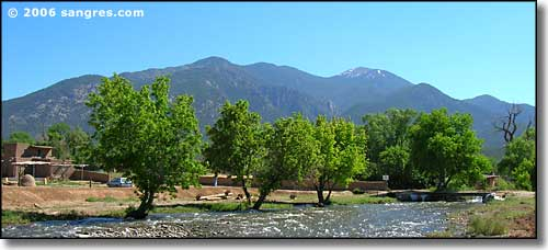 Wheeler Peak rising above Taos Pueblo