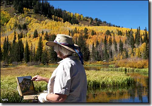 An artist working beside the Big Cottonwood Canyon Scenic Byway