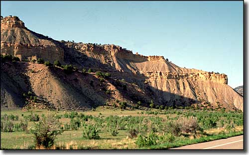 Red sandstone cliffs along the side of Indian Canyon Scenic Byway